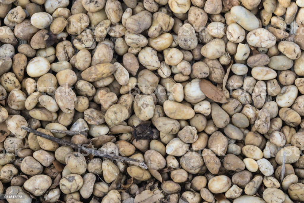 Stone wall., Wet crashed stones of railway ballast and small dry leaves after light rain stock photo