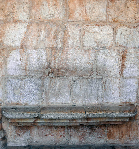 Stone wall with bench. stock photo