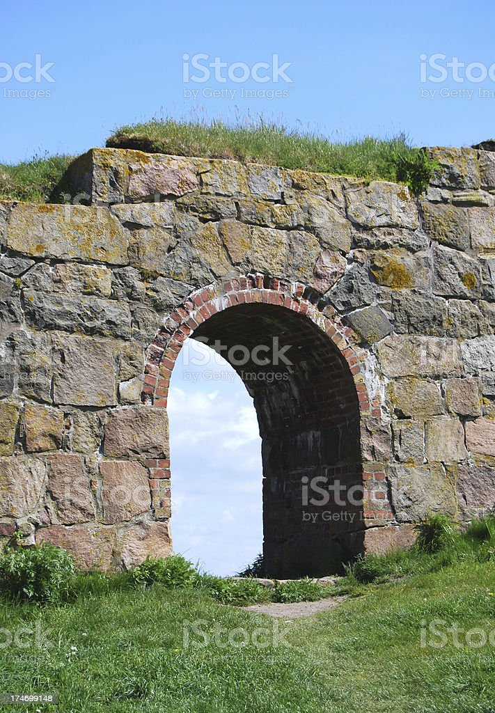 Stone wall with gate stock photo
