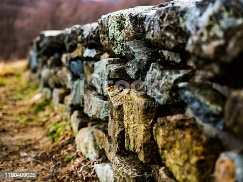 Stone wall with moss along the edge of a scenic overlook in the Blue Ridge Mountains.