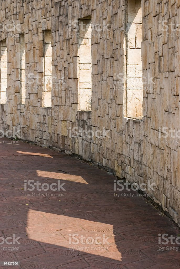 Stone wall with windows on it royalty-free stock photo