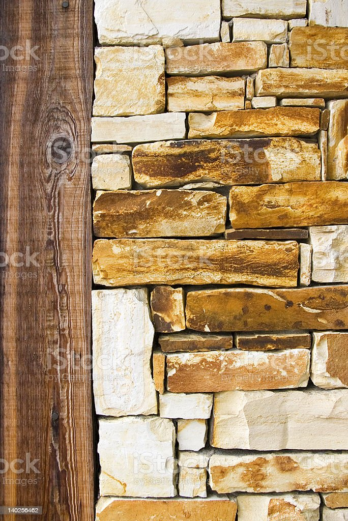 Stone wall with wooden frame royalty-free stock photo