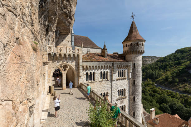 Stone walls of historic Basilica of St-Sauveur blend into the cliff in Rocamadour, France