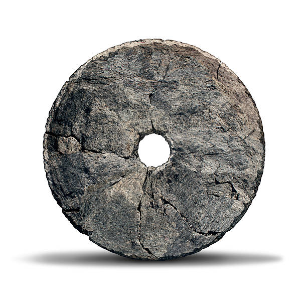 Stone Wheel Stone wheel object as an early invention of the prehistoric era and ancient symbol of technology and innovation designed by a caveman on a white background. antediluvian stock pictures, royalty-free photos & images