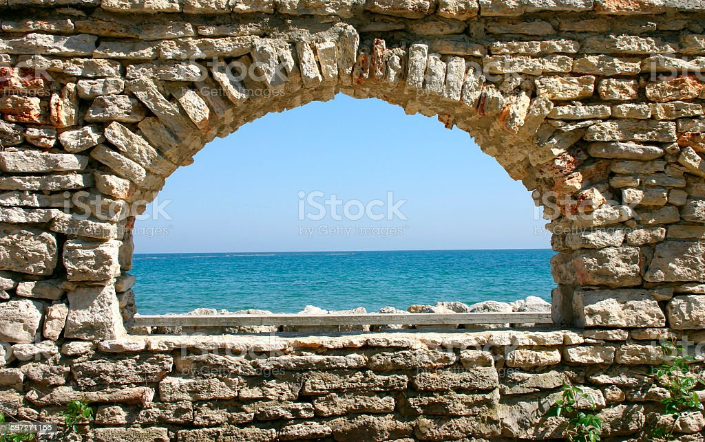 stone window overlooking the sea royalty-free stock photo
