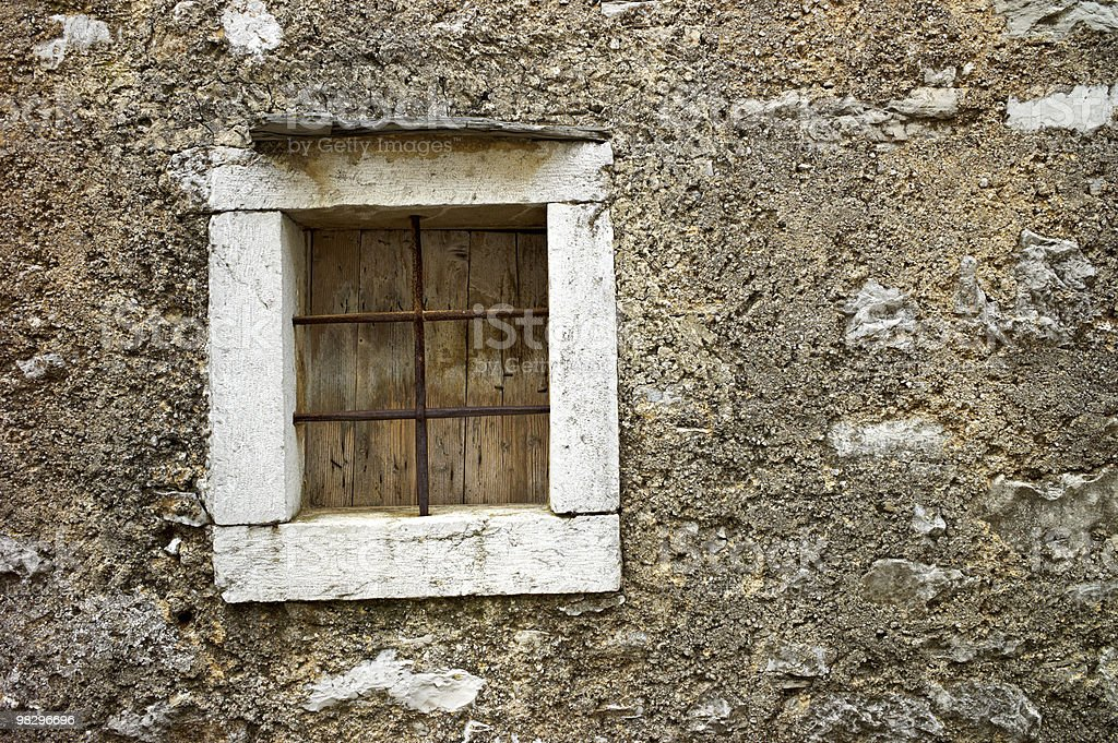 Stone window with iron royalty-free stock photo
