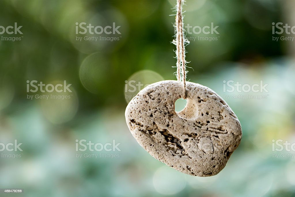 stone with a hole against blurred background with copyspace stock photo