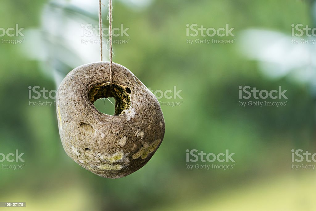 stone with a natural hole against  blurred background with copy stock photo