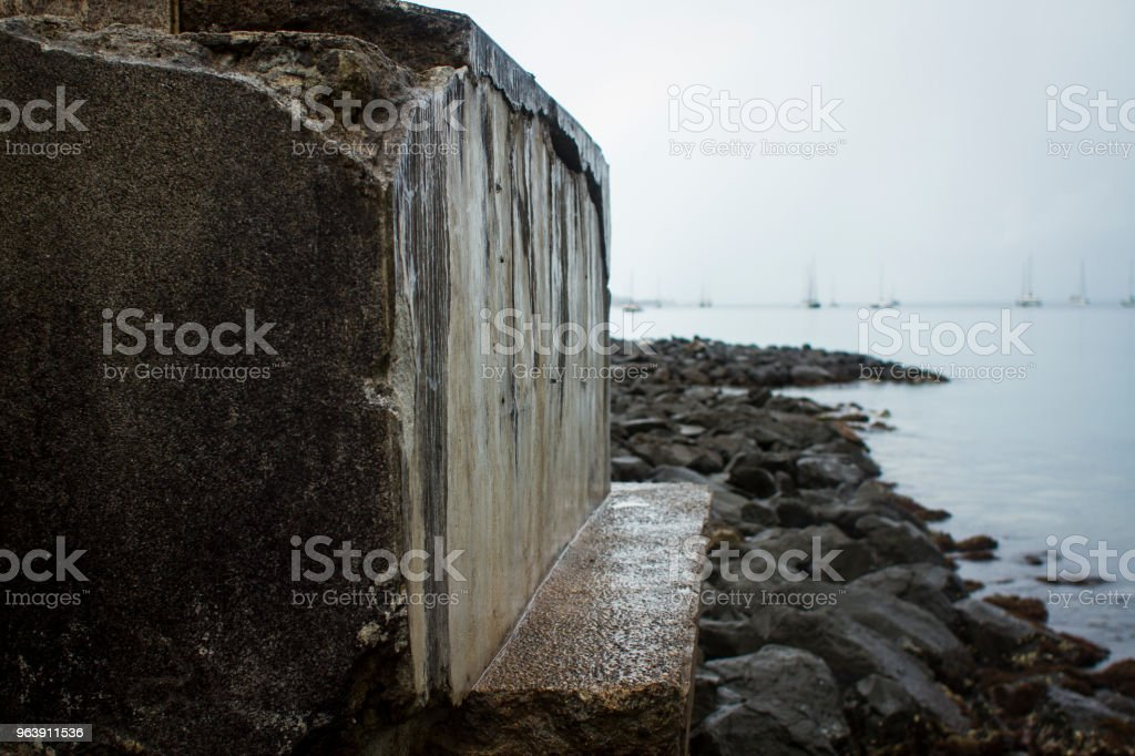 Stone with ships in the distance stock photo