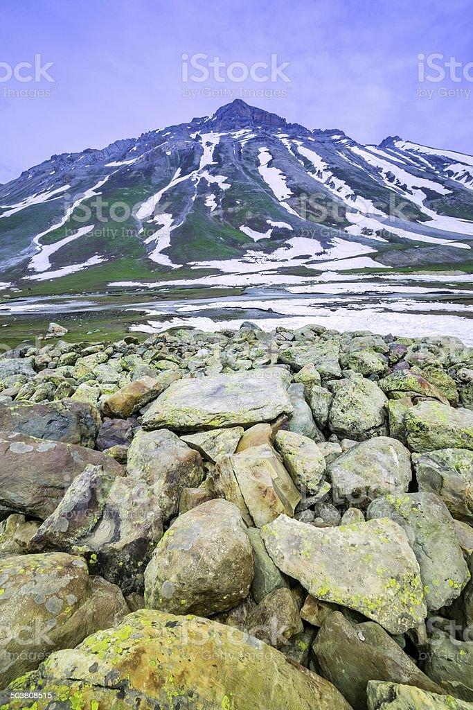 stone with snow mountain stock photo