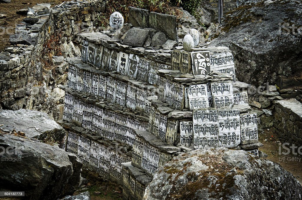 Stone with the Buddhist mantras royalty-free stock photo