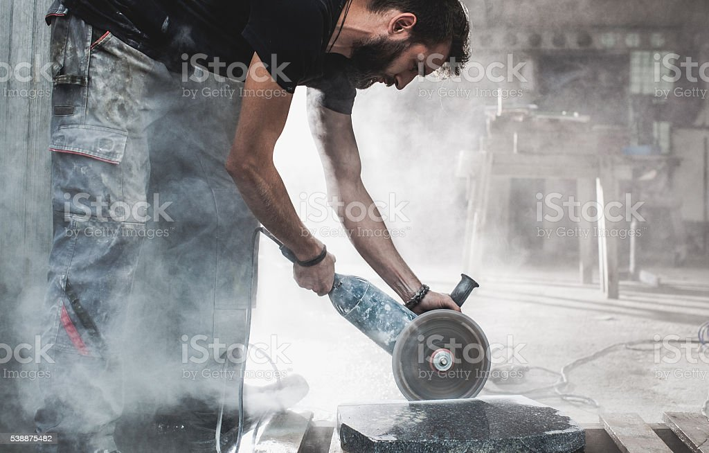 Stonecutter at his workshop stock photo