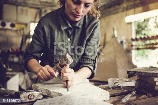 Stonecutter woman portrait at work, Ljubljana, Slovenia