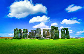 Stonehenge an ancient prehistoric stone monument on blue sky background at Wiltshire, UK.
