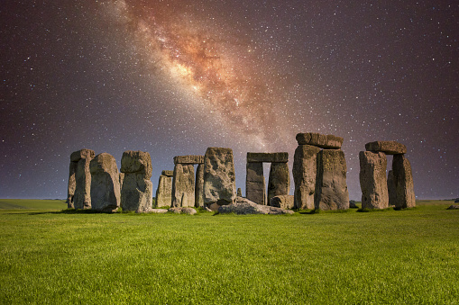 Stonehenge at night with starry milky way sky on winter solstice.