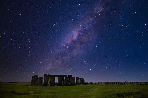 Stonehenge at night with starry sky on winter solstice.