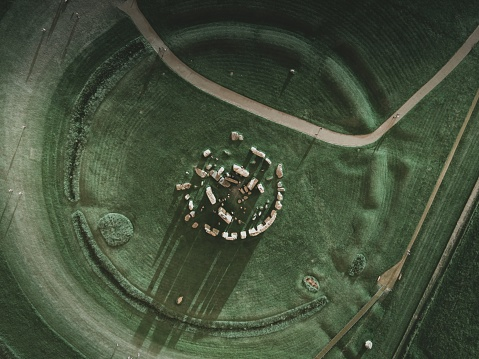 Aerial view above stone henge, as the shadows are cast making it look like a sundial.