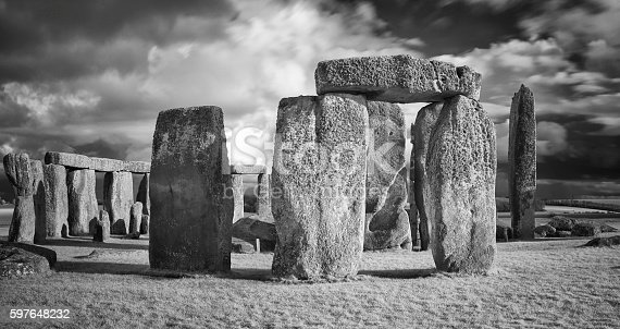 A dramatic sky looms over the ancient neolithic monument of Stonehenge in Wiltshire, England.