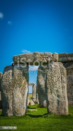 Stonehenge unesco world heritage site near Salisbury in England. Summer holidays destination in the UK, Europe. View of stone archways at Stonehenge in British countryside on a sunny day, England.