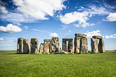 Stonehenge with a blue cloudy sky.