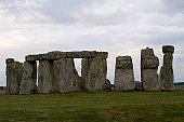 Wiltshire, England, UK - April 28, 2011: Tourists at Stonehenge explore and photograph the monument. Over 800,000 tourists visit Stonehenge each year.