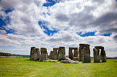 Mystical Stonehenge on a sunny day, blue sky with clouds, England, UK.