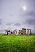 Sun peeking out at Stonehenge, UK