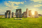 Crowds of visitors encircle the massive megalith monument of prehistoric Stonehenge on the Salisbury Plain in Wiltshire England.