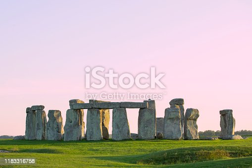 Famous standing stones of Stonehenge in Wiltshire, England. Sunlight, Clear sky, green grass, no people.