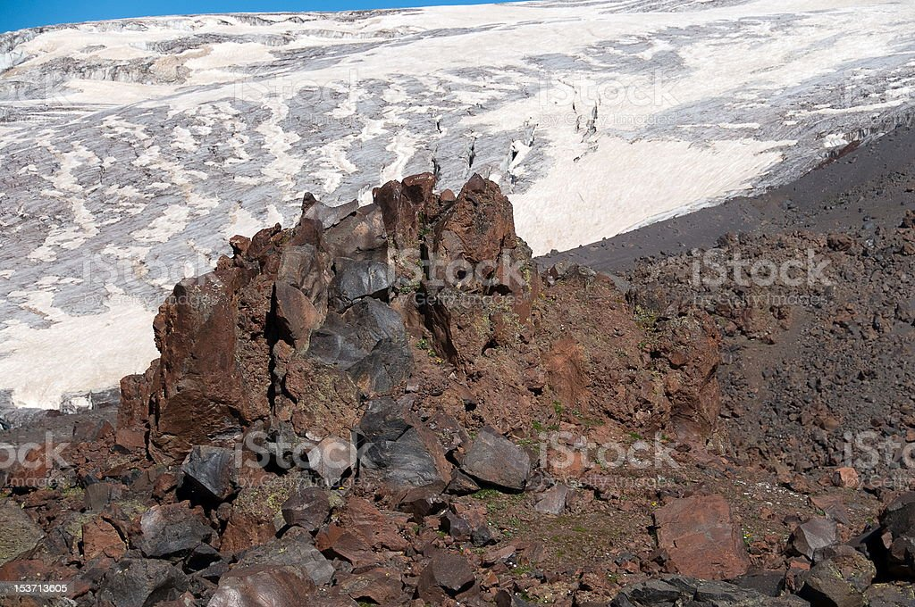 Stones against a glacier royalty-free stock photo