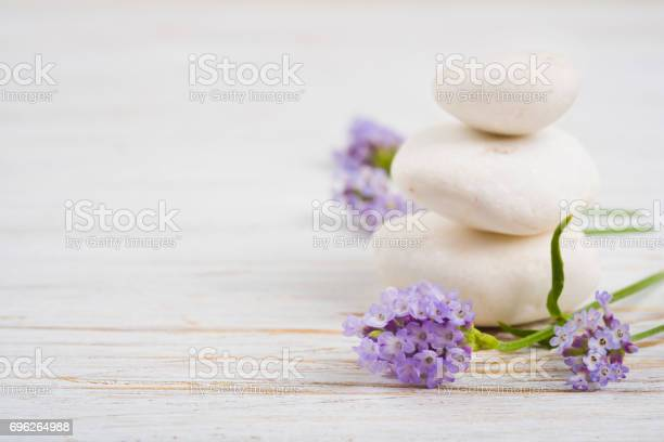 Stones and twigs with lavender flowers on wooden table picture id696264988?b=1&k=6&m=696264988&s=612x612&h=psgdv 1pxn9aqxf0hh zm8t5snhpagyxuqgshd1inds=