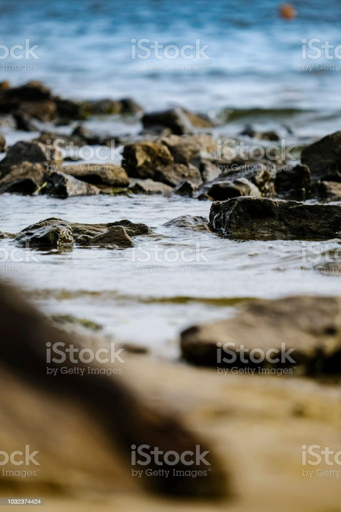 Stones and waves close up stock photo