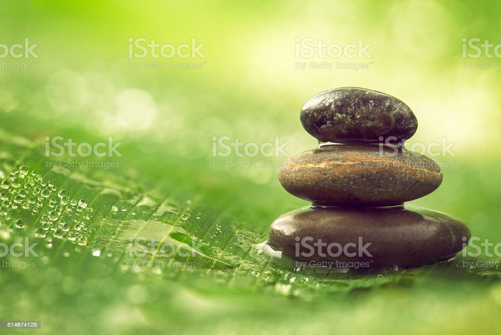 Stones balance and water drops stock photo