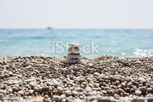 591835714 istock photo Stones balance at the beach 537516370