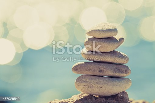 istock Stones balance at the beach, stack over blue sea 487028542