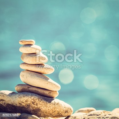 istock Stones balance vintage pebbles stack background 525217689