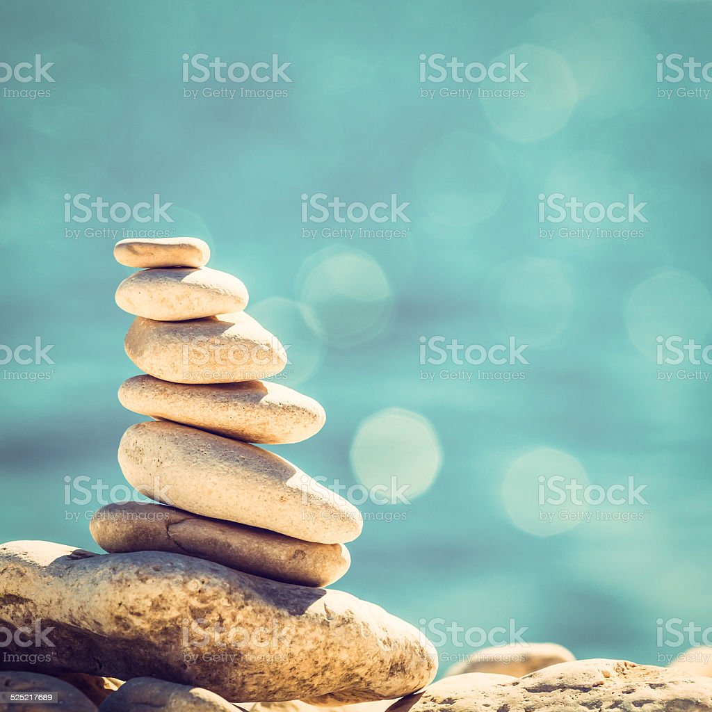 Stones balance vintage pebbles stack background stock photo