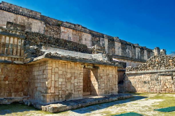 stones carved in buildings surrounding the courtyard of uxmal. archaeological site of uxmal, located in yucatan. beautiful tourist area. unesco world heritage site. - uxmal stock photos and pictures