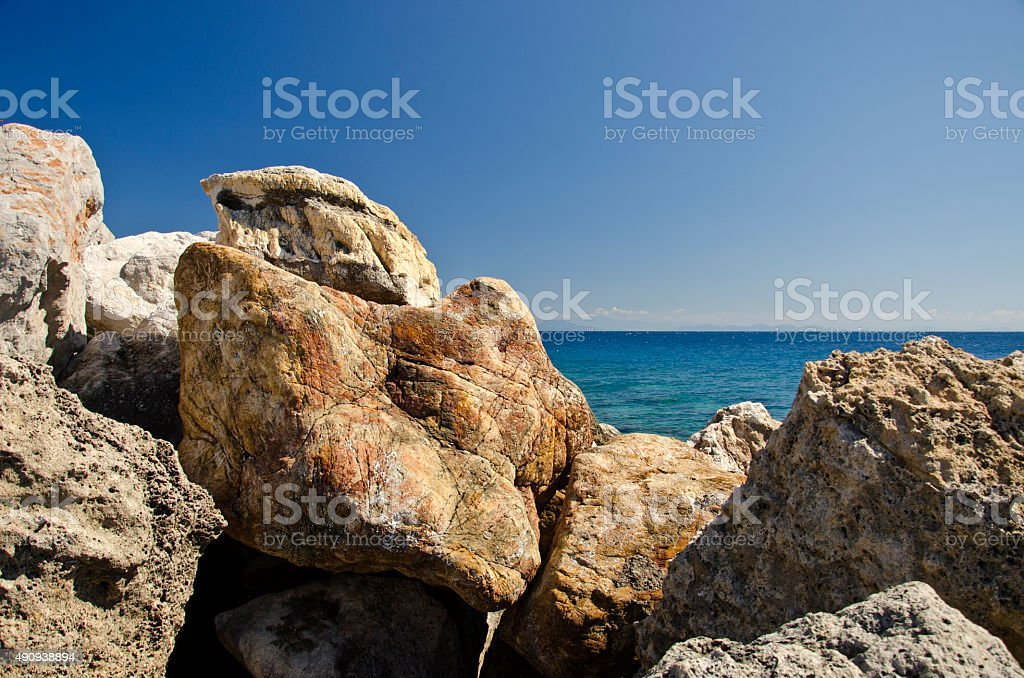 Stones for breaking waves in Greece stock photo