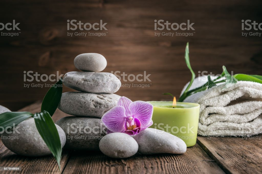 Stones hot stone, Orchid, bamboo and candle. Zen relaxation stock photo