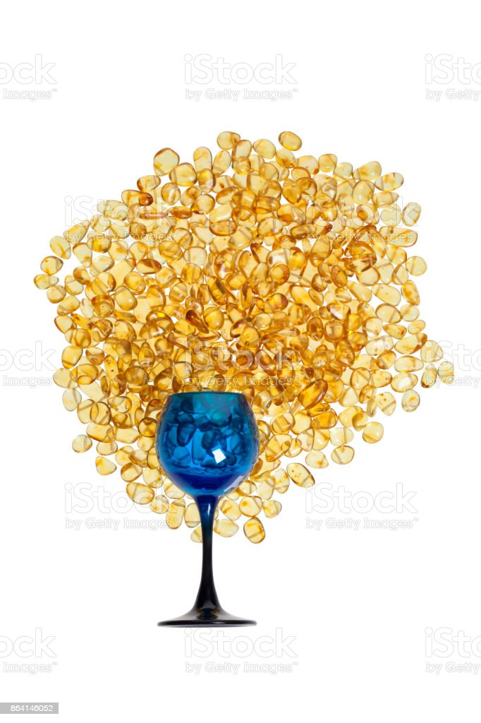 Stones of yellow amber and blue glass on a white background. royalty-free stock photo