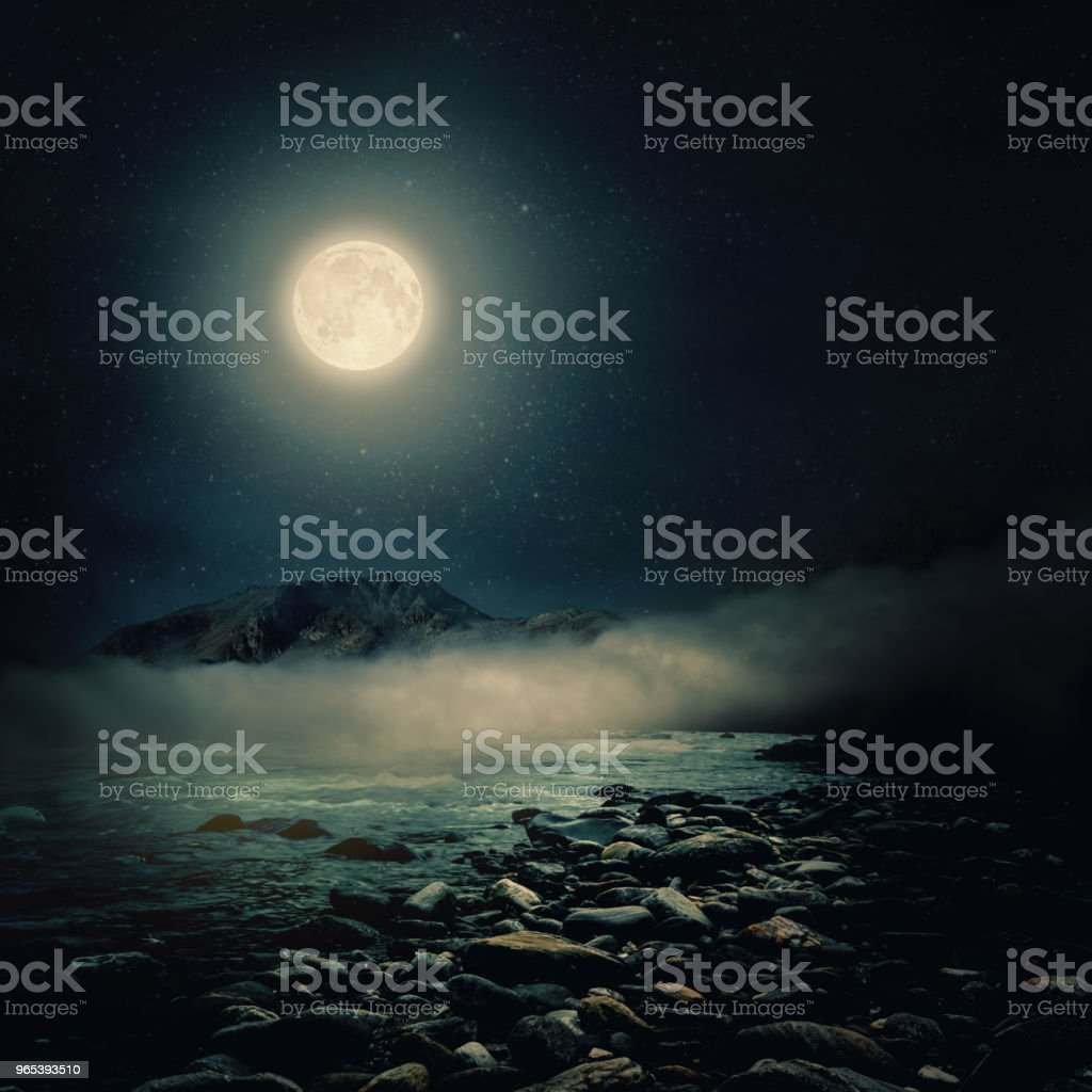 Stones on a background of blurred sea with mountain views royalty-free stock photo