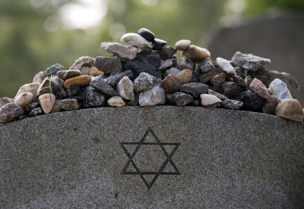 Stones on a Jewish grave. Remembrance stones left on a Jewish grave in Bonaventure Cemetery, Savannah Georgia. judaism stock pictures, royalty-free photos & images