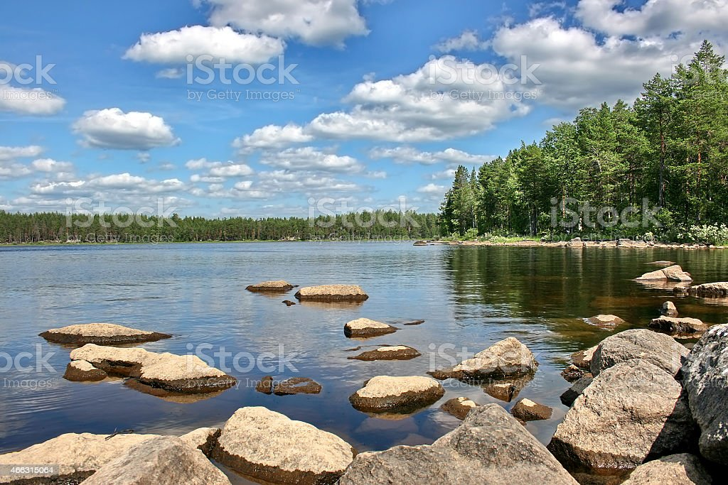 Stones on a  lake surface.  Karelia, Russia. stock photo