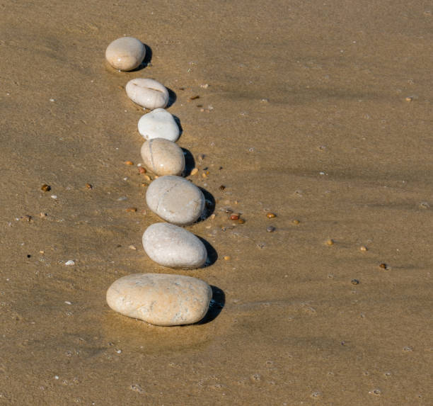 Stones on a Sand Beach - foto stock