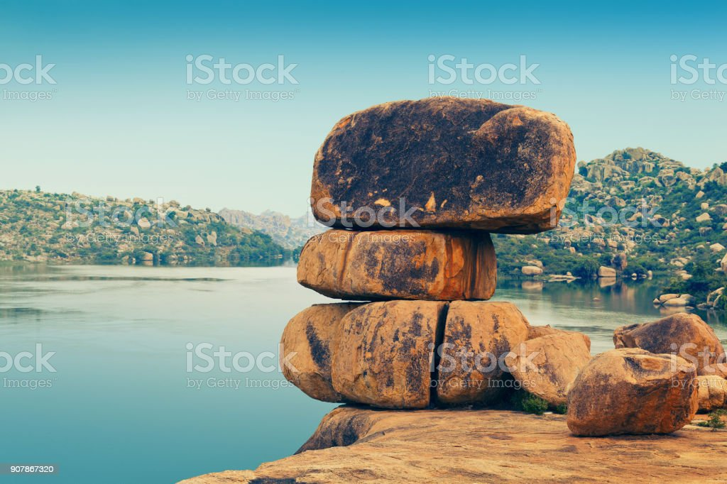 Stones on the bank of Sanapur Lake stock photo