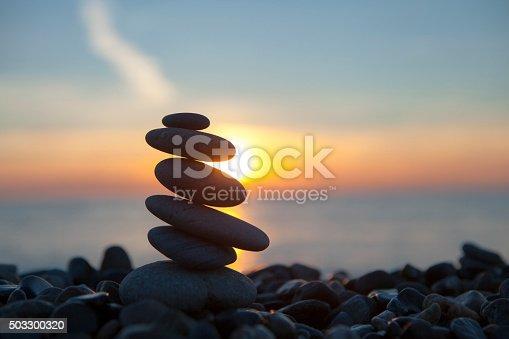 istock stones on the beach, sun, sea, sunset 503300320
