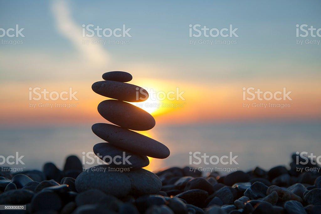 stones on the beach, sun, sea, sunset stock photo