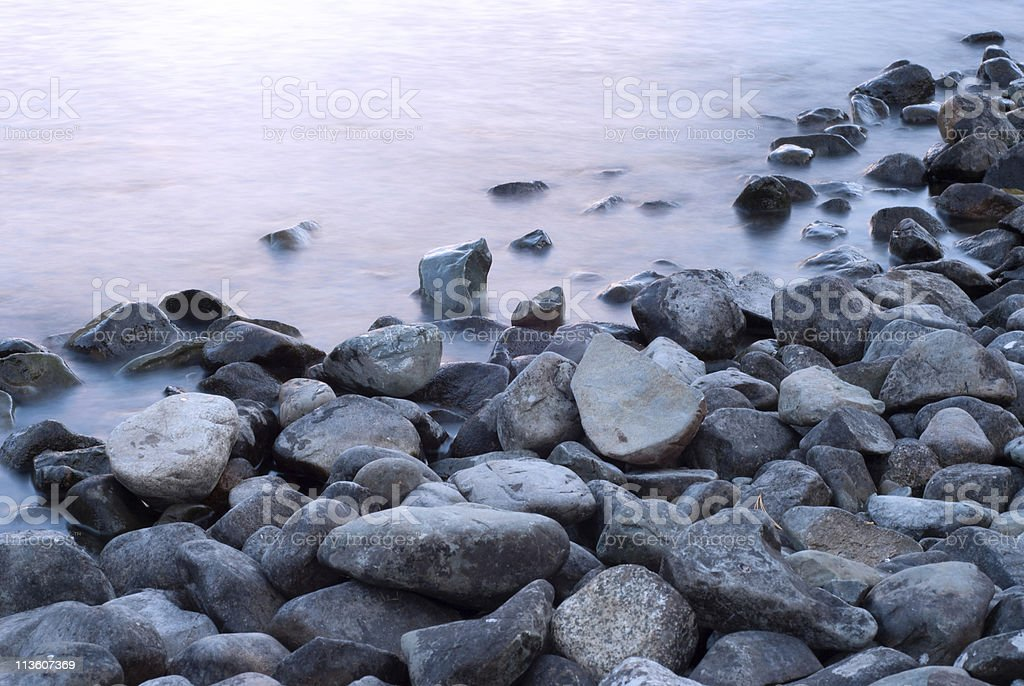 Stones on the shore of Lake royalty-free stock photo
