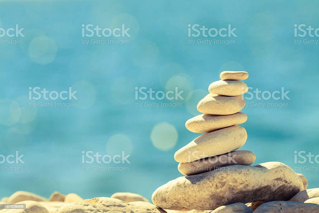 Stones pebbles balance at the beach, stack over blue sea stock photo